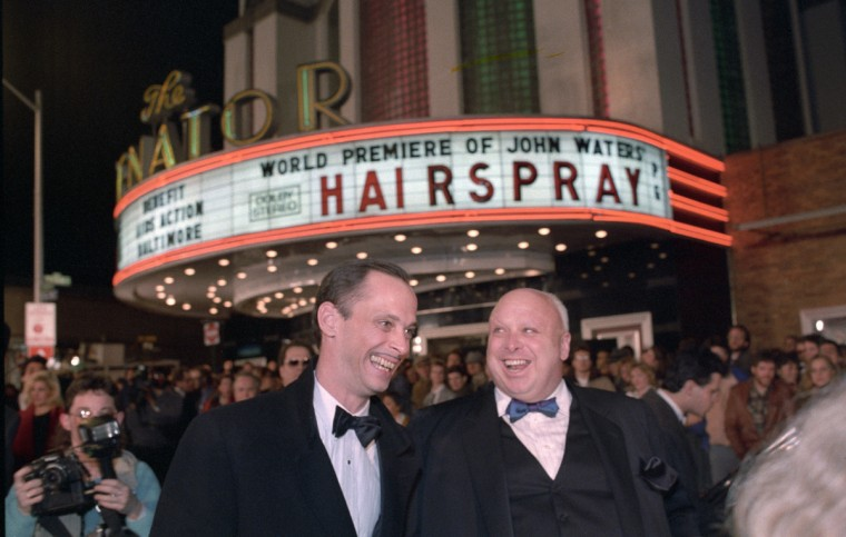 "Baltimore director John Waters and drag queen extraordinaire Divine, aka Harris Glenn Milstead, share a light moment outside the Senator Theatre at the world premiere of ""Hairspray"" in 1988. (Amy Davis/Baltimore Sun)"