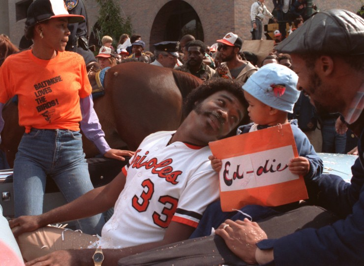 "First baseman Eddie Murray takes it all in from the back seat of a convertible during the victory parade after the Orioles beat the Philadelphia Phillies four games to one in ""The I-95 Series"" in 1983. (Baltimore Sun)"