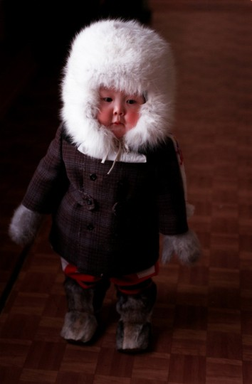 A Sun photographer on assignment met this rosy-cheeked child in reindeer skin boots and a hat made from Arctic fox fur in a grocery store in a tiny Siberian village in 1996. (Barbara Haddock Taylor/Baltimore Sun)