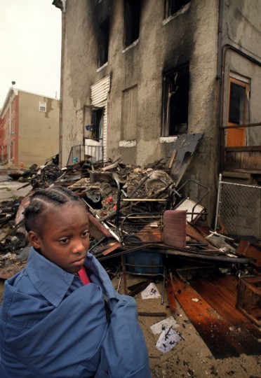 "Marilyn Johnson, 10, knew the victims of the arson that killed Angela and Carnell Dawson and their five children in October 2002 in their home on East Preston Street. A 22-year-old drug dealer angry at their ""snitching"" pleaded guilty in 2003 and was sentenced to life in prison. (Amy Davis/Baltimore Sun)"