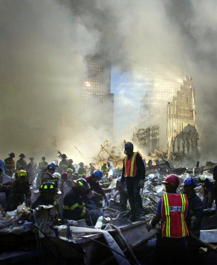 Rescue workers shift rubble by hand at the World Trade Center site in New York the day after the terrorist attacks of September 11, 2001, in a search for survivors. (John Makely/Baltimore Sun)