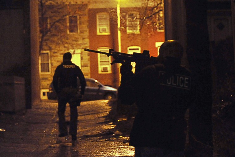 "Police take up positions in a Baltimore alley during a drug raid on Lombard Street in 2011. Among those arrested was Felicia Pearson, who played ""Snoop"" on the TV series ""The Wire."" (Kim Hairston/Baltimore Sun)"