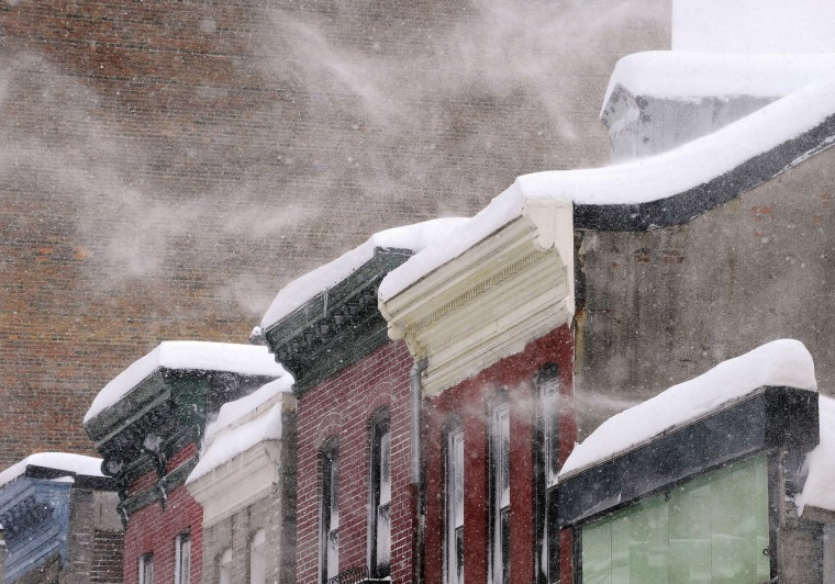 Park Avenue rooftops looked like icing on a cake after two major snowstorms on February 5-10, 2010. The storms dropped more than 40 inches and made it the snowiest month on record in Baltimore. (Jed Kirschbaum/Baltimore Sun)