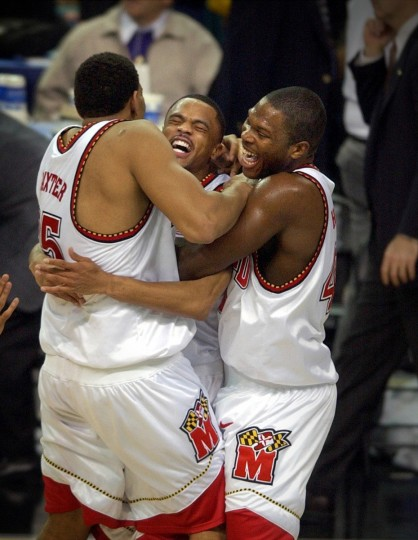 Lonny Baxter, Juan Dixon and Tahj Holden celebrate Maryland's 64-52 victory over Indiana and first NCAA men's basketball championship in 2002. (Kenneth K. Lam/Baltimore Sun)