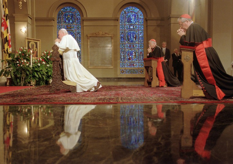 Pope John Paul II prays at the Basilica of the Assumption during a visit to Baltimore in 1995. America's first cathedral was designed by Benjamin H. Latrobe, the architect of the U. S. Capitol. (Chiaki Kawajiri/Baltimore Sun)