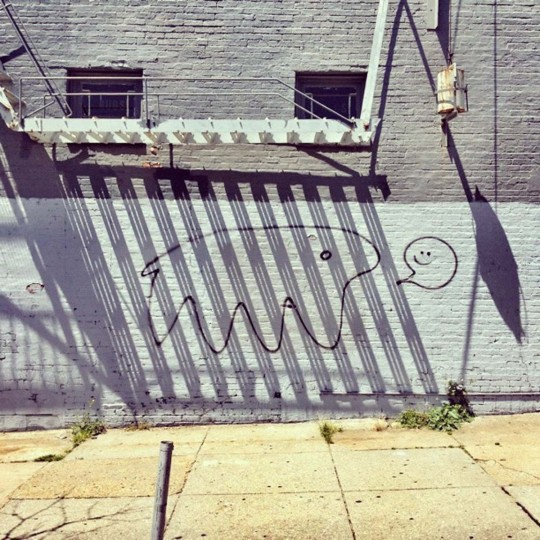 """c(re)a(tur)g[e]d – This somewhat shoddy graffiti was only on this wall on Chestnut Ave in Hampden for a few weeks, and the shadow """"caging"""" the creature was only there for a few minutes, a perfect example of a photo I would never have without my phone. (Credit: Josh Flynn)"""