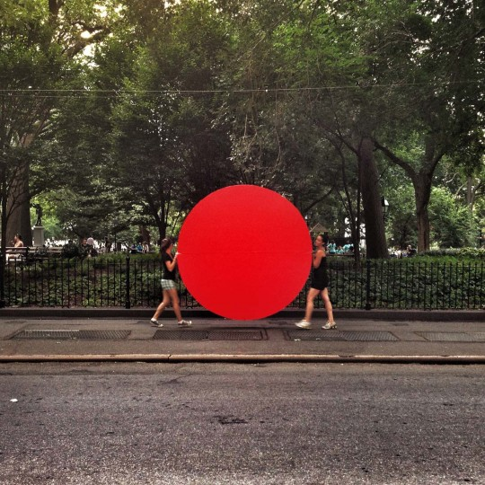 This is a shot near Washington Square Park I took on a trip to NYC a few months ago. It's not every day you see two women carrying a huge red circle down the road. I like it for its candidness, but it looks like it was set up. (Credit: Josh Flynn)