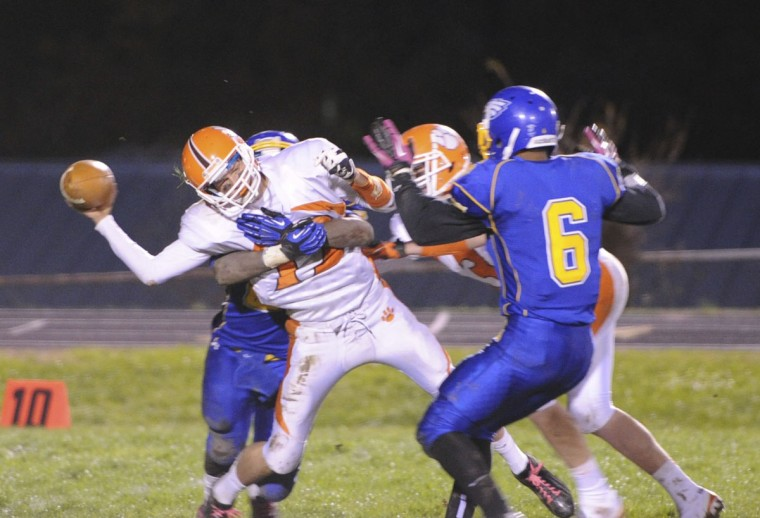 Fallston's Brandon Weinhold gets tackled in a Saturday night game against Aberdeen. (Nicole Munchel/Baltimore Sun Media Group)
