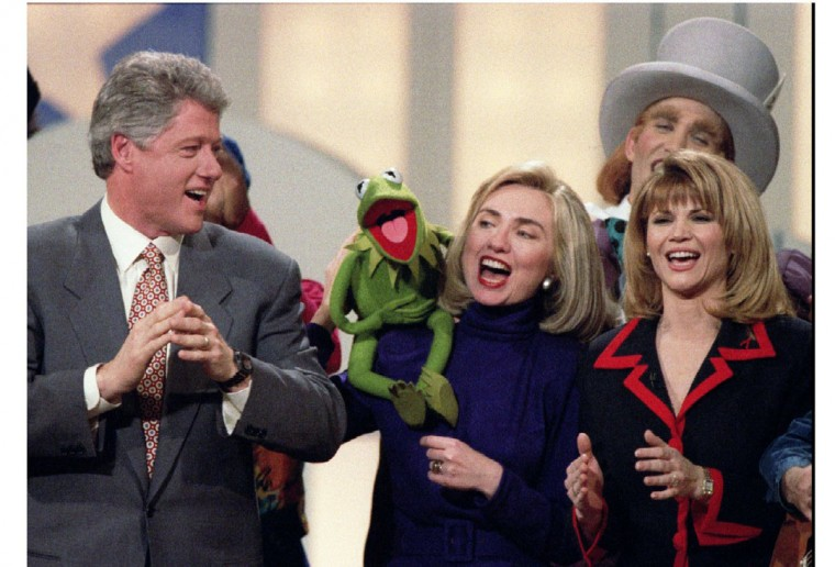 President-elect Bill Clinton, left, looks on as Sesame Street and the Muppets' Kermit the Frog sings on his wife Hillary's shoulder at an event at the Kennedy Center. At right is actress Markie Post. (Win McNamee/Reuters/File photo)