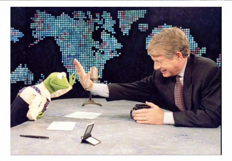 Ted Koppel, the host of ABC News' Nightline program, high fives Sesame Street (and The Muppet Show) character Kermit the Frog during the taping of Larry King Live. Kermit filled in for Larry King as host of the show as an April Fools Day joke. (Sam Kittner/Reuters)