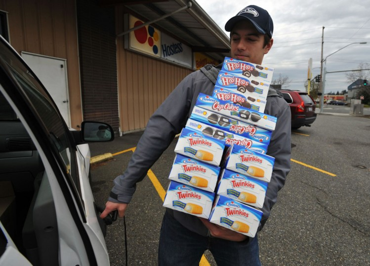 Andy Wagar loads Twinkies, Ho-Hos and cupcakes into a van outside the Wonder Bakery Thrift Shop in Bellingham, Wash., after Hostess Brands filed a motion to liquidate the company's holdings. (Philip A. Dwyer/Bellingham Herald/MCT Photo)