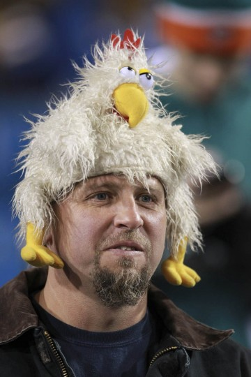 A chicken hat keeps one fan warm as the Miami Dolphins pay a visit to the Buffalo Bills at Ralph Wilson Stadium in Orchard Park, New York. (Charles Trainor Jr./Miami Herald/MCT)