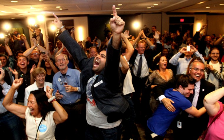 Democratic supporters react as President Barack Obama is projected to defeat Mitt Romney to win re-election during campaign party in Orlando, Florida, on Tuesday, November 6, 2012. (Joe Burbank/Orlando Sentine)