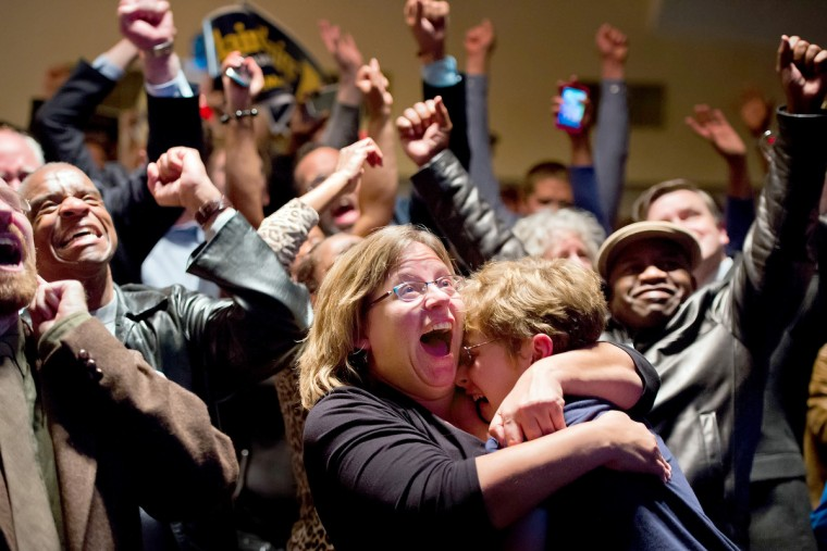 Michelle Zielinski, center, hugs Jared Goudsmit after President Barack Obama is projected to win during an election watch party at the Chase Park Plaza Hotel in St. Louis, Missouri, on Tuesday, November 6, 2012. (David Eulitt/Kansas City Star/MCT)