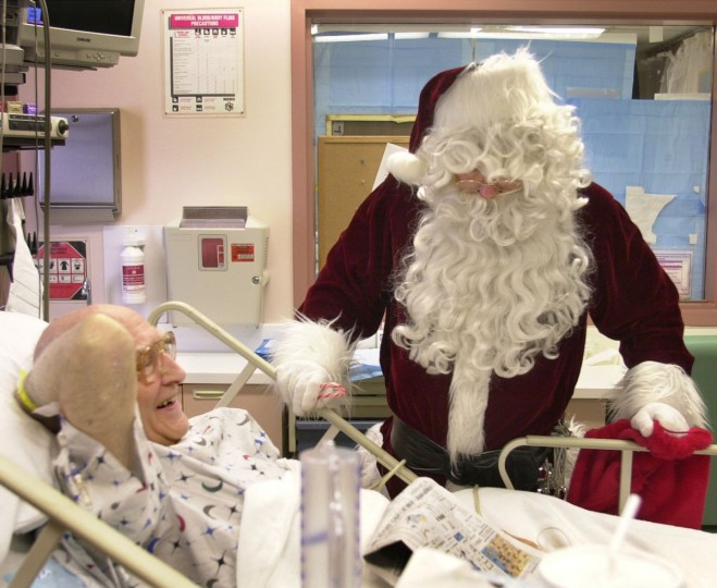 Larry Budd dressed as Santa visits Homer A. Sander, a patient at Shock Trauma on December 23, 2002. Budd almost died after a jet skiing accident seven years ago, but doctors at Shock Trauma saved his life, and the Laurel man has been going back every Christmas dressed as Santa. (Jerry Jackson