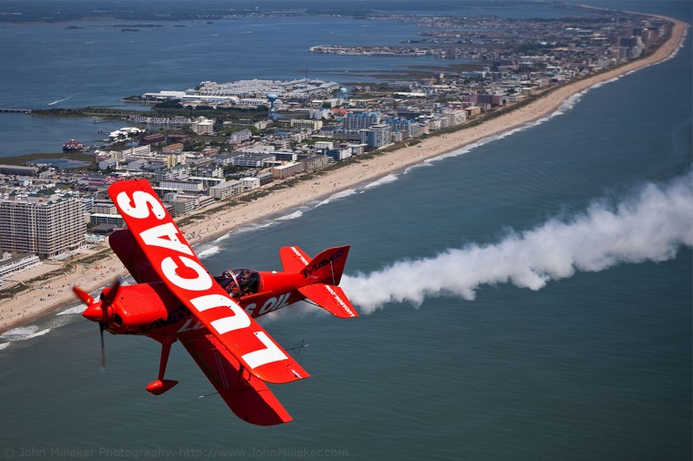 """Mike Wiskus above Ocean City: Sometimes you've got to put away your fears when you're asked to face your fears. Like getting the shot nearly hanging out of a plane only secured by a 4"""" nylon strap."""