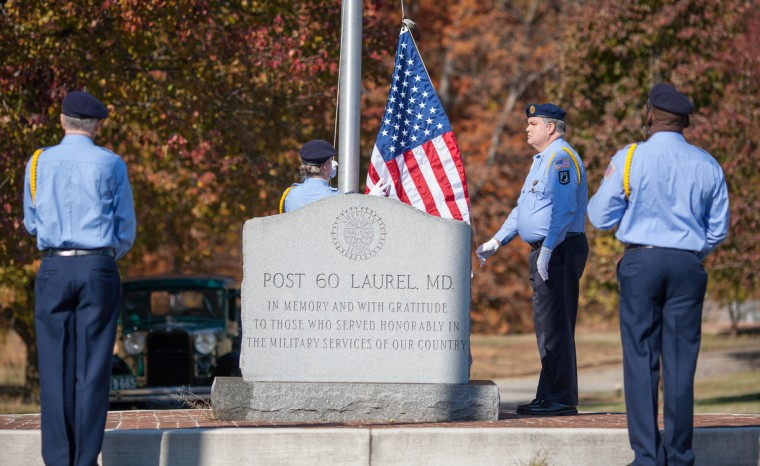 A new American Flag is secured and raised by Post 60 members during the ceremony Sunday morning. The Laurel American Legion Post 60 held a flag raising ceremony at Ivy Hill Cemetery. (Nate Pesce/Baltimore Sun Media Group)