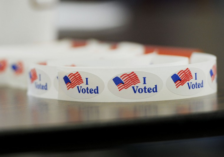 "A roll of ""I Voted"" stickers waits for voters inside a polling place at Medfield Heights Elementary School. (Jon Sham/Baltimore Sun Media Group)"