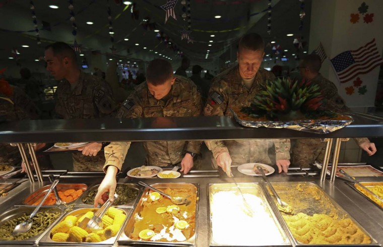 U.S. soldiers take their food during a Thanksgiving meal in Kabul. (Omar Sobhani/Reuters photo)