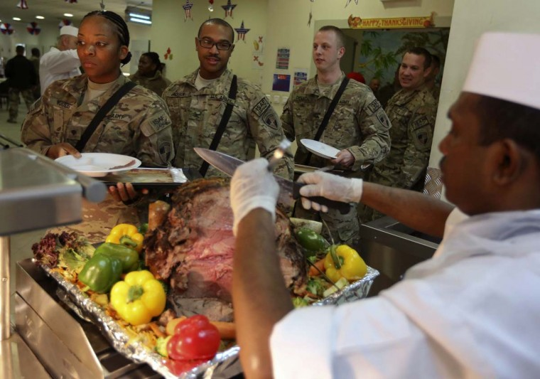 U.S. soldiers queue to take food during a Thanksgiving meal in Kabul. (Omar Sobhani/Reuters photo)