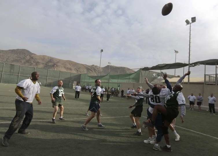 U.S. troops play touch football in the early morning hours on Thanksgiving at a military base in Kabul. (Omar Sobhani/Reuters photo)