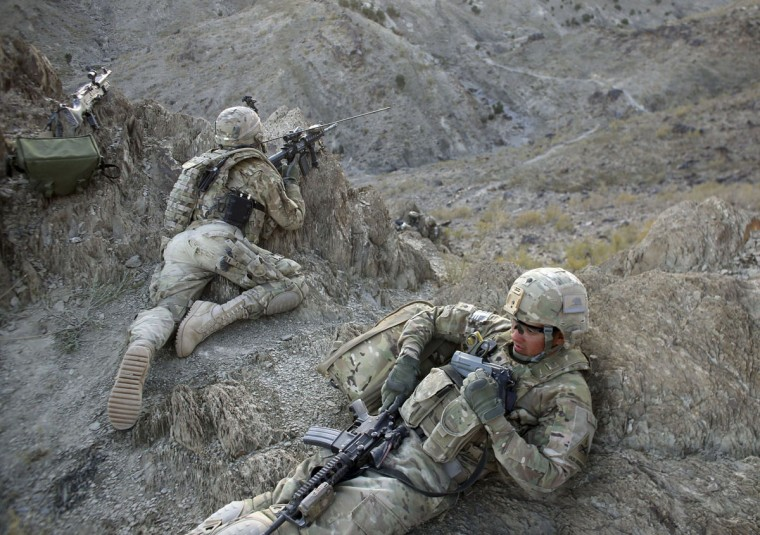 U.S. soldiers aim their weapons as they expect a Taliban attack near the town of Walli Was in Paktika province, near the border with Pakistan. (Goran Tomasevic/Reuters)