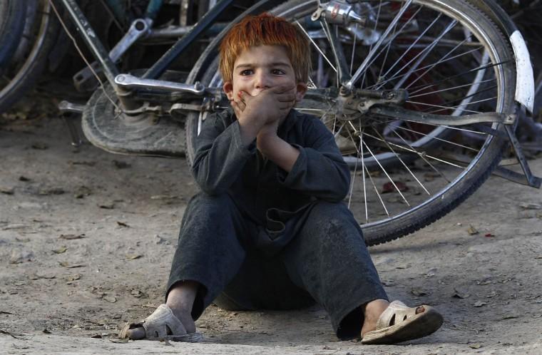 An Afghan boy sits on a roadside in Kabul. (Adnan Abidi/Reuters)