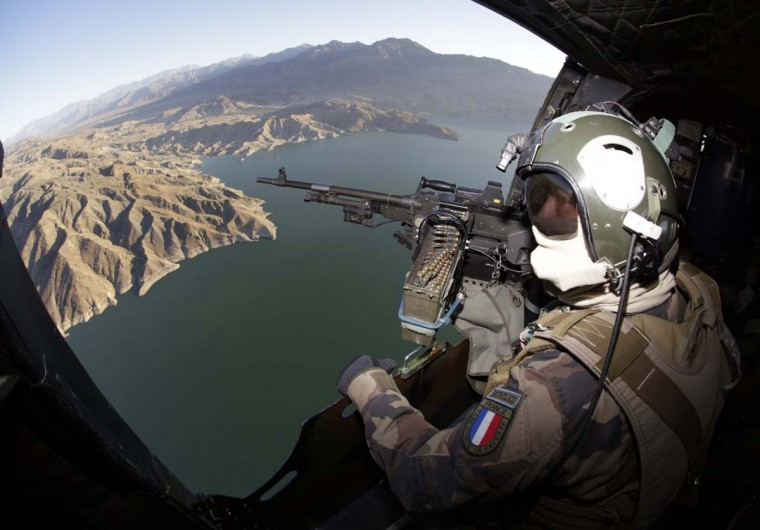 A French gunner checks the area aboard a helicopter during a flight to the French base in Naghlu November 19, 2012. French combat troops are due to pull out of Afghanistan by the end of the year. (Eric Gaillard/Reuters)