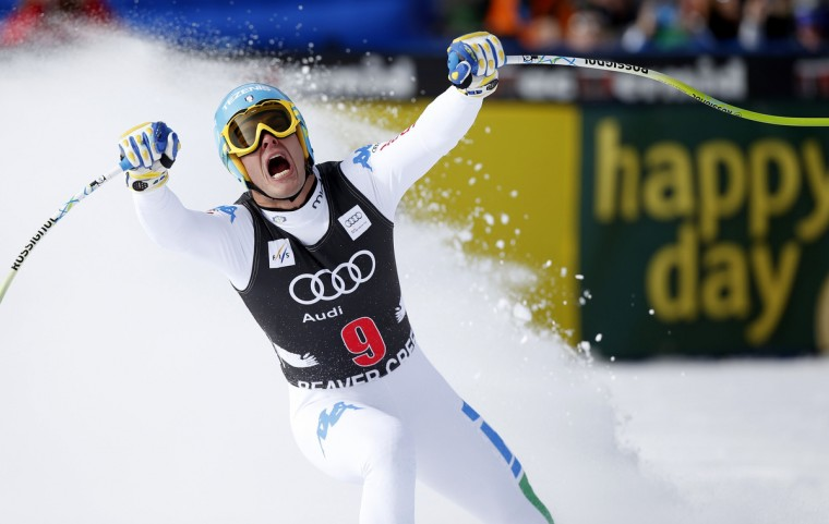 Christof Innerhofer of Italy celebrates setting the best time as he skis into the finish area in men's World Cup downhill ski race in Beaver Creek, Colorado. (Rick Wilking/Reuters)