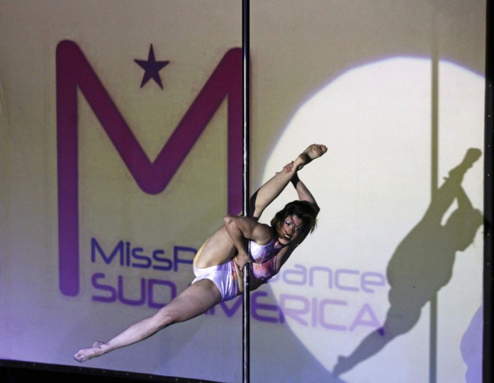 Rafaela Montanaro of Brazil performs during the Miss Pole Dance South America 2012 competition in Buenos Aires, November 26, 2012. (Marcos Brindicci/Reuters)