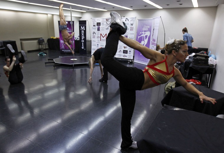 Participants stretch backstage before the Miss Pole Dance South America 2012 competition in Buenos Aires, November 26, 2012. (Marcos Brindicci/Reuters)