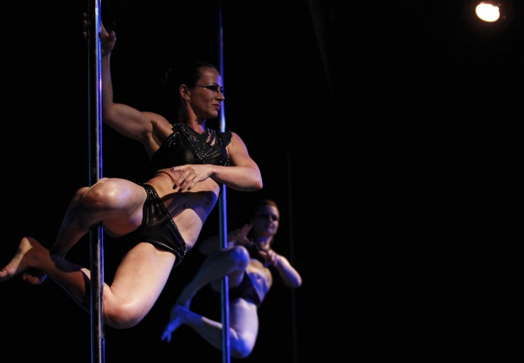 Soeli Coradassi (L) and Karen Horbus of Brazil perform in the doubles category at the Miss Pole Dance South America 2012 competition in Buenos Aires, November 26, 2012. (Marcos Brindicci/Reuters)