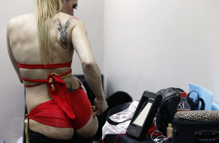 A participant applies make-up before the Miss Pole Dance South America 2012 competition in Buenos Aires, November 26, 2012. (Marcos Brindicci/Reuters)