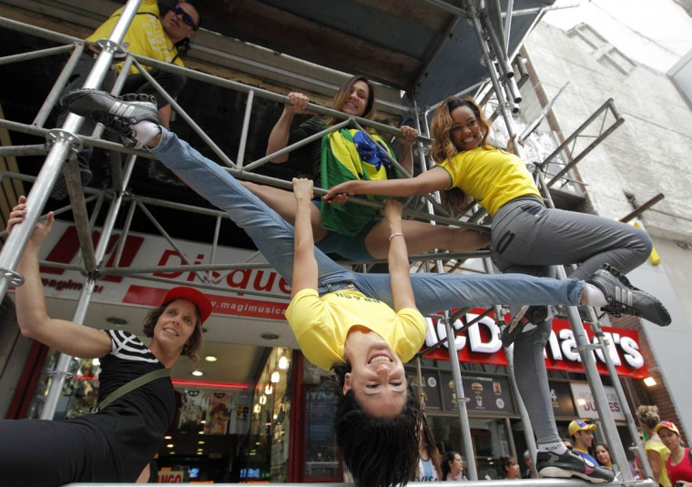Performers do a pole dancing routine to promote the Miss Pole Dance South America 2012 competition in Buenos Aires November 23, 2012. (Enrique Marcarian/Reuters)