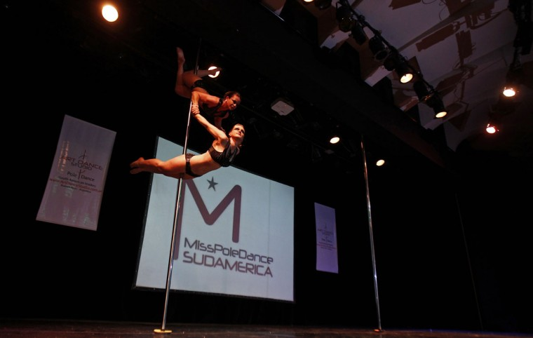 Karen Horbus (bottom) and Soeli Coradassi of Brazil perform in the doubles category at the Miss Pole Dance South America 2012 competition in Buenos Aires, November 26, 2012. (Marcos Brindicci/Reuters)