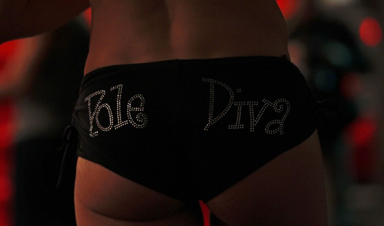 Pole dancer Lolo Hislum of France, who participated as judge at the Miss Pole Dance South America 2012 competition, wears short pants that read 'Pole Diva' in Buenos Aires, November 26, 2012. )Marcos Brindicci/Reuters)