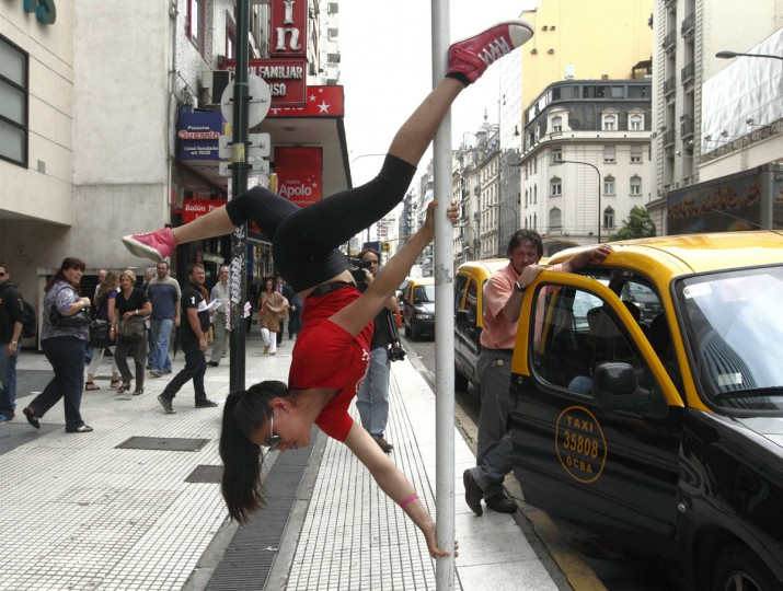 Mariela Duffoo, from Peru, performs a pole dancing routine to promote the Miss Pole Dance South America 2012 competition in Buenos Aires November 23, 2012. (Enrique Marcarian/Reuters)