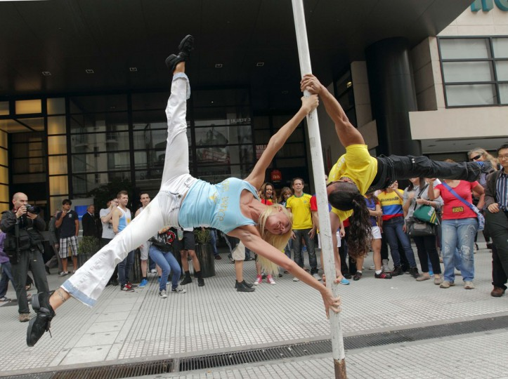 Daniela Schmoll, of Argentina (L), performs a pole dancing routine to promote the Miss Pole Dance South America 2012 competition in Buenos Aires November 23, 2012. (Enrique Marcarian/Reuters)