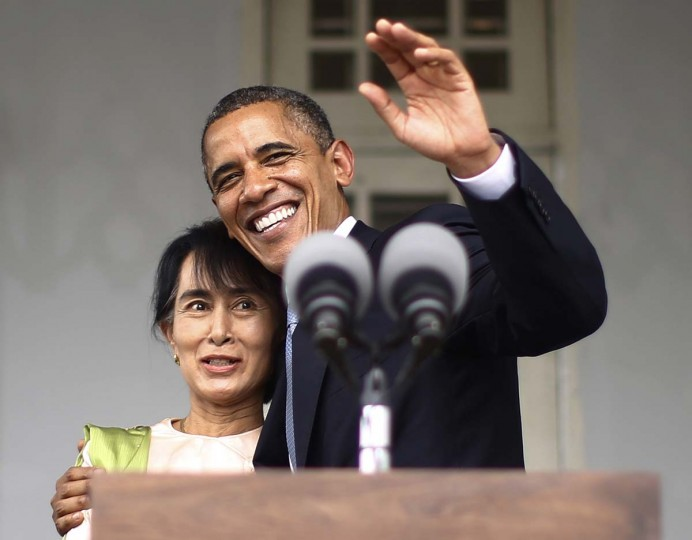 U.S. President Barack Obama (R) waves with Aung San Suu Kyi at her residence in Yangon, November 19, 2012. President Obama became the first serving U.S. president to visit Myanmar on Monday, trying during a whirlwind six-hour trip to strike a balance between praising the government's progress in shaking off military rule and pressing for more reform. (Jason Reed/Reuters)