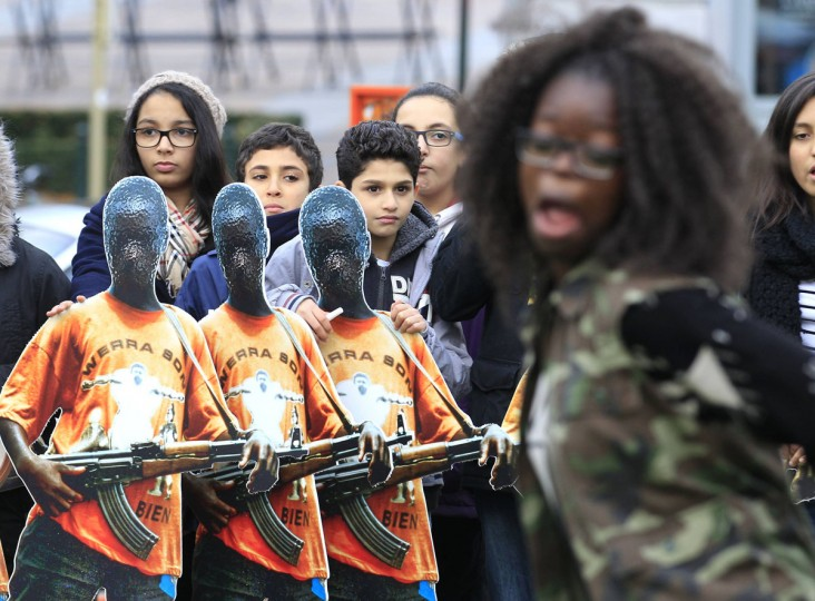 Belgian students hold pictures depicting child soldiers during a protest by Amnesty International in Brussels November 12, 2012. (Yves Herman/Reuters)