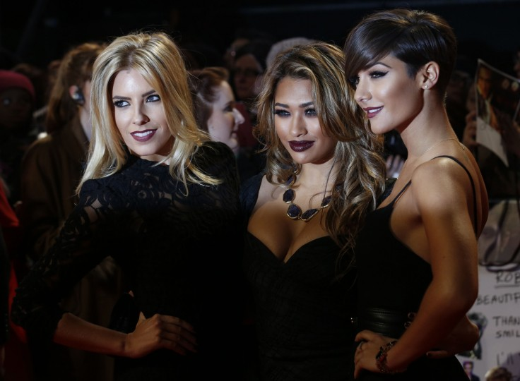 """Mollie King (L), Vanessa White (C) and Frankie Sandford of the music group The Saturdays arrive for the European premiere of """"The Twilight Saga: Breaking Dawn Part 2"""" in London. (Luke MacGregor/Reuters)"""