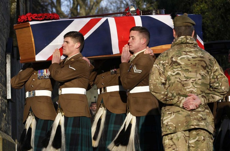 Soldiers from the Royal Regiment of Scotland carry the coffin of Captain Walter Barrie before his funeral service at Glencorse Kirk near Edinburgh, Scotland. Captain Barrie, of The Royal Scots Borderers, 1st Battalion The Royal Regiment of Scotland (1 Scots), was playing in a soccer match between British soldiers and members of the Afghan National Army (ANA) on Remembrance Day at their base in Helmand province in Afghanistan, when he was shot by a rogue member of the Afghan army, according to local media. (David Moir/Reuters photo)
