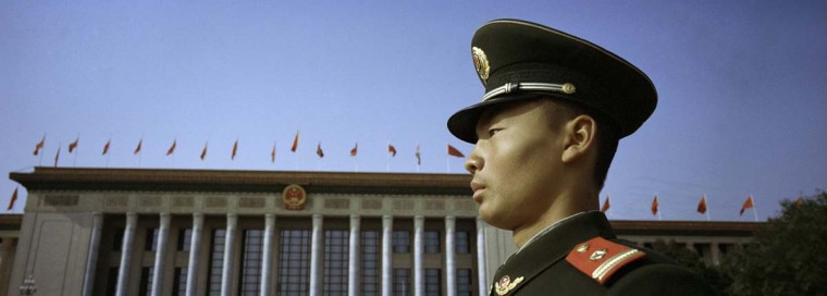 A paramilitary police officer stands in front of the Great Hall of the People, venue of the 18th National Congress of the Communist Party of China in Beijing November 8, 2012. Picture taken November 8, 2012. (Carlos Barria/Reuters photo)