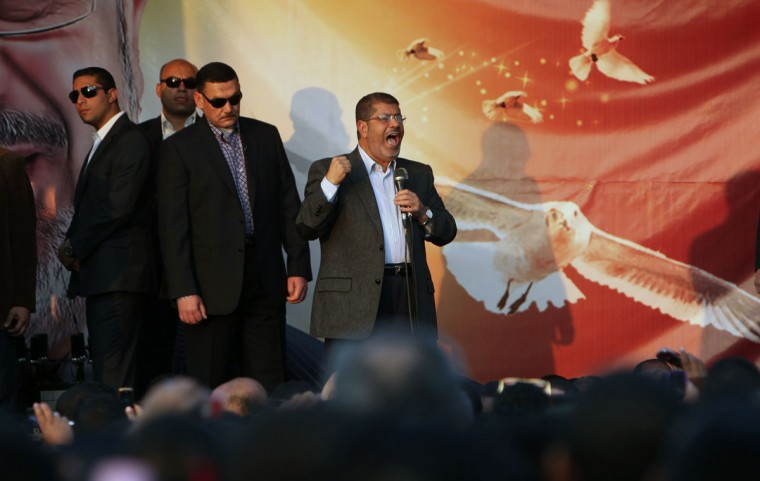 Egypt's President Mohamed Mursi (C) speaks to supporters in front of the presidential palace in Cairo November 23, 2012. (Asmaa Waguih/Reuters)