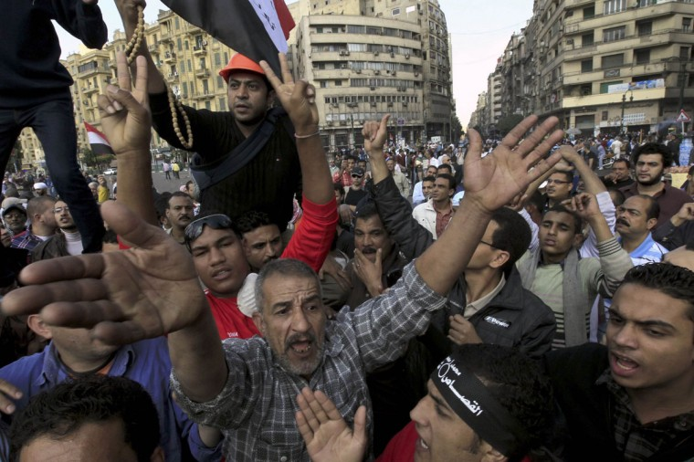 Protesters chant slogans against Egyptian President Mohamed Mursi during a demonstration at Tahrir square in Cairo November 23, 2012. (Mohamed Abd El Ghany/Reuters)