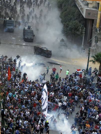 Protesters run from tear gas released by riot police during clashes at Tahrir square in Cairo November 23, 2012. (Mohamed Abd El Ghany/Reuters)