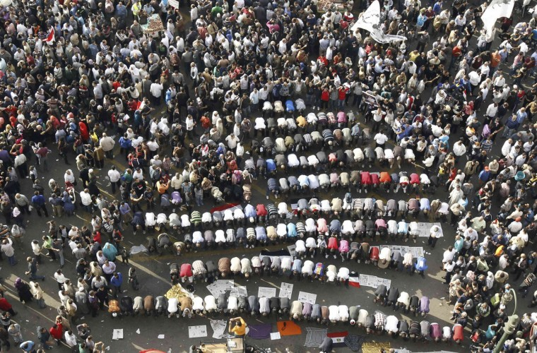 Protesters pray as they gather at Tahrir square in Cairo November 23, 2012. (Mohamed Abd El Ghany/Reuters)