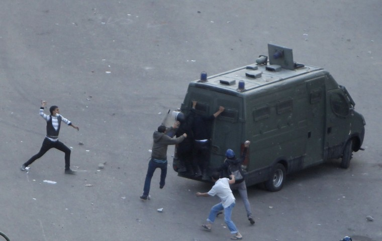 Protesters and riot police clash at Tahrir square in Cairo November 23, 2012. (Mohamed Abd El Ghany/Reuters)