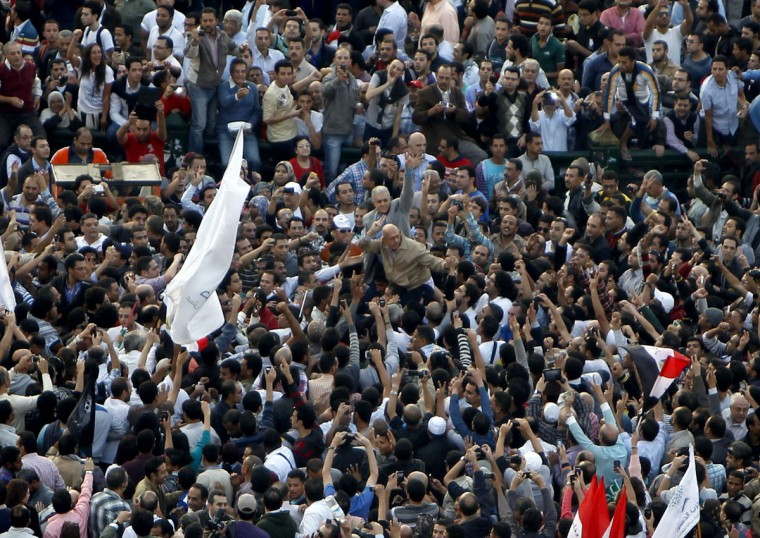 Constitution Party founders' representative Mohamed ElBaradei and Hamdeen Sabahi, former presidential candidate and founder of Al-Karama Party, join protesters at Tahrir square in Cairo November 23, 2012. (Mohamed Abd El Ghany/Reuters)
