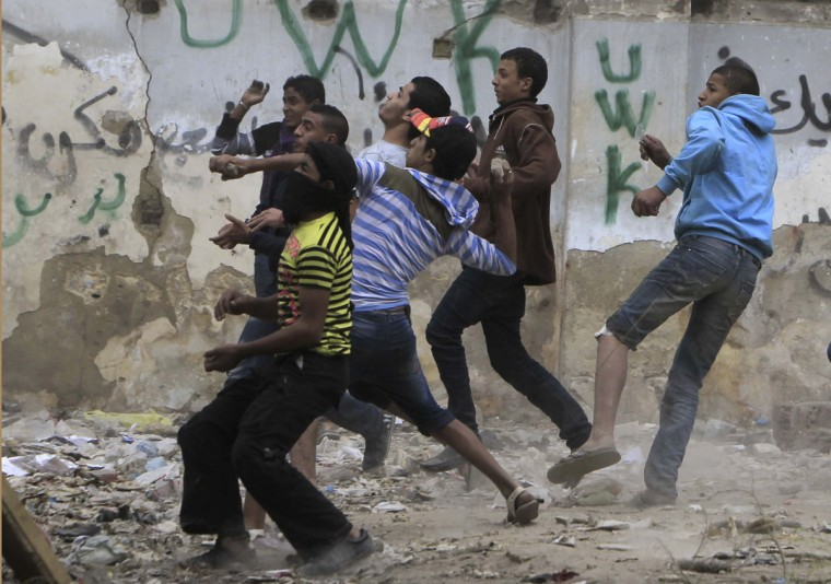 Protesters throw stones at police during clashes at Tahrir square in Cairo November 23, 2012. (Mohamed Abd El Ghany/Reuters)